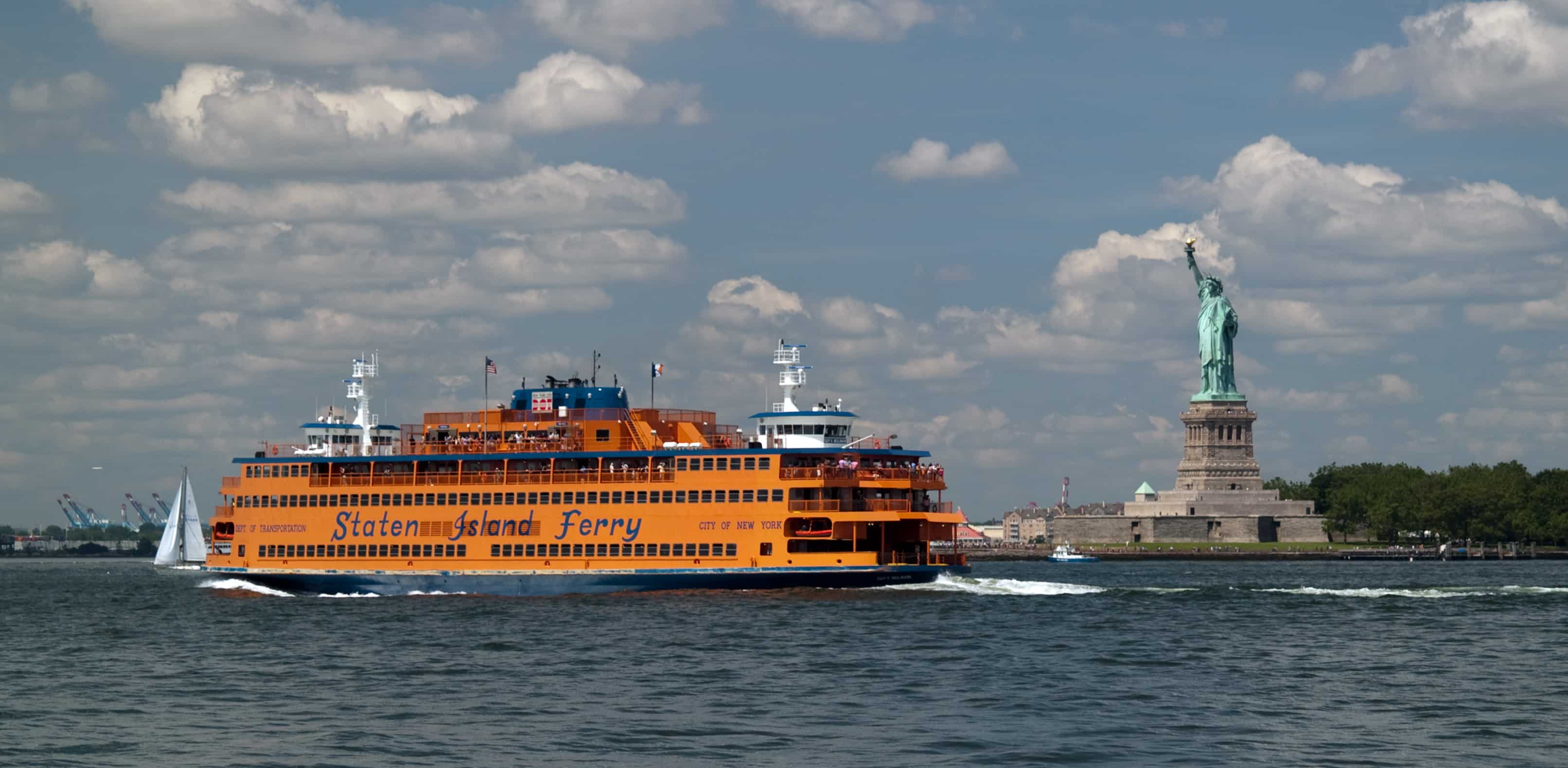 Staten Island ferry passes the Statue of Liberty